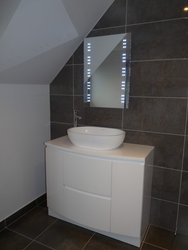Bathroom with LED backlit mirror