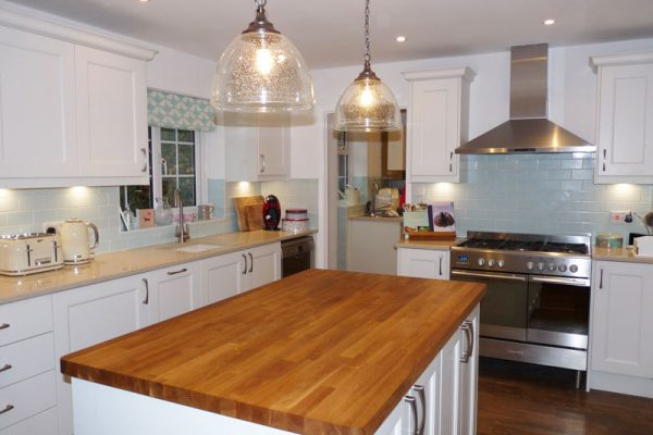 Traditional white shaker style kitchen with quartz worktop and island wood worktop