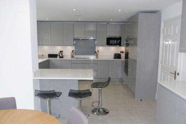 J Groove dove grey gloss kitchen and quartz worktop and breakfast bar fleet