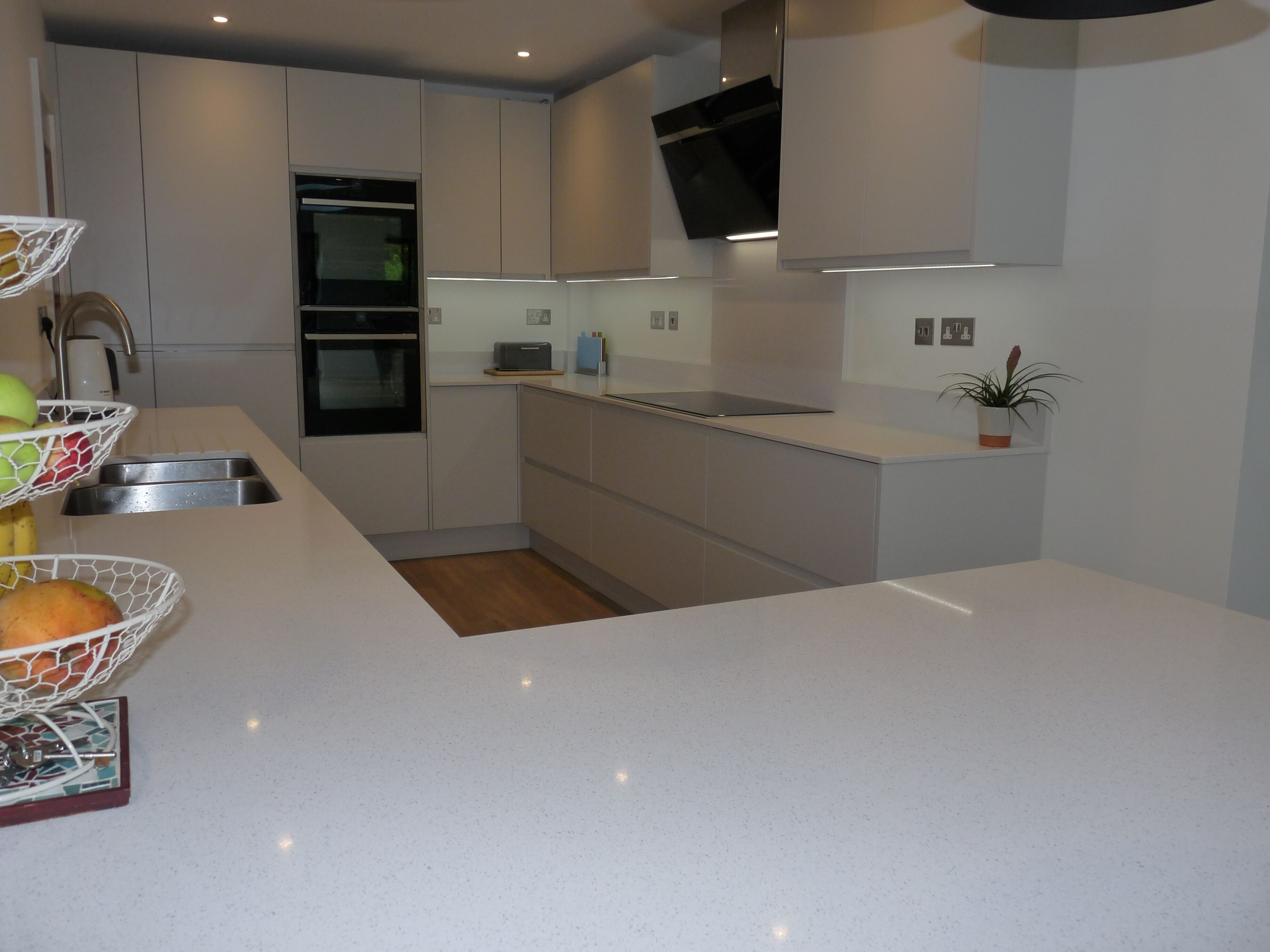 LED under unit lighting in J groove gloss grey kitchen